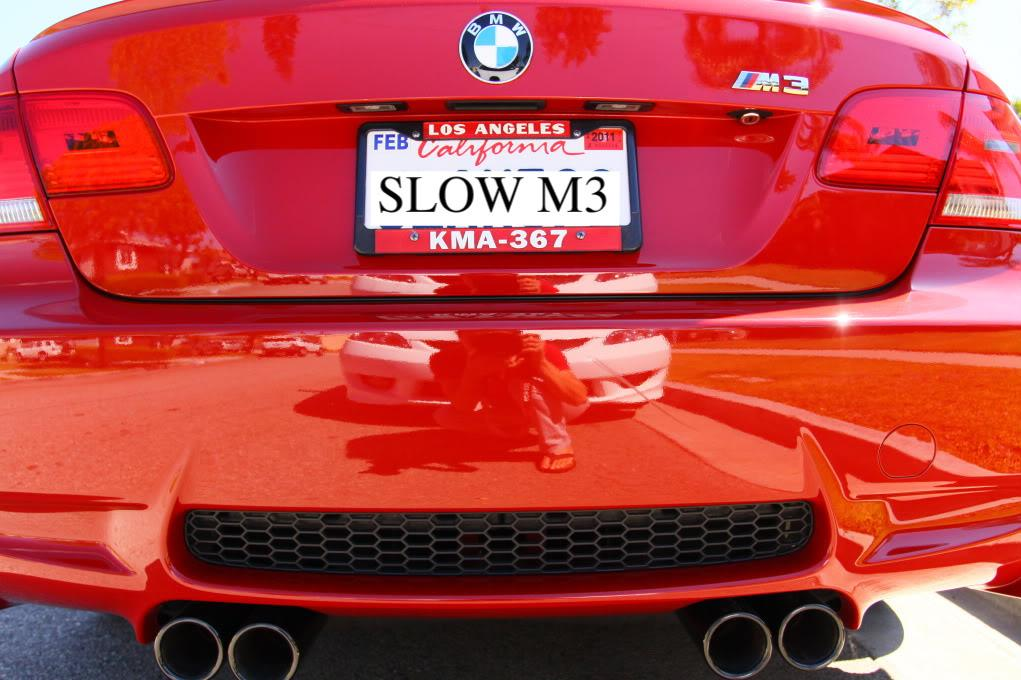 a bmw owner shows off his license plate with a lapd call sign some frames are available only to officers others are sold publicly